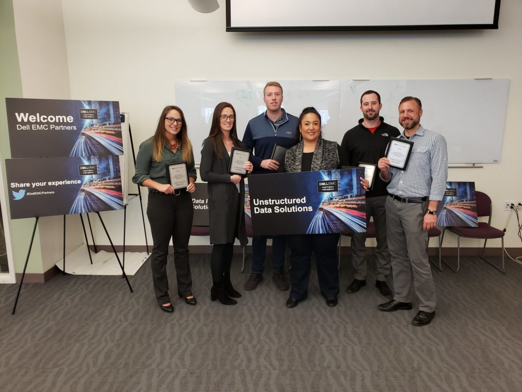 Hunter McBain and his team winning the case study challenge for Unstructured Data Solutions with Dell EMC.