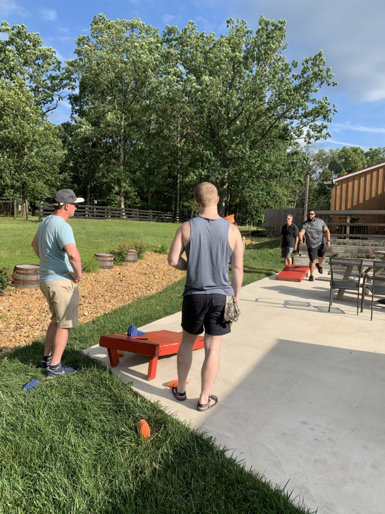 Some of our inside sales representatives and account managers went head to head on a game of corn hole during our happy hour