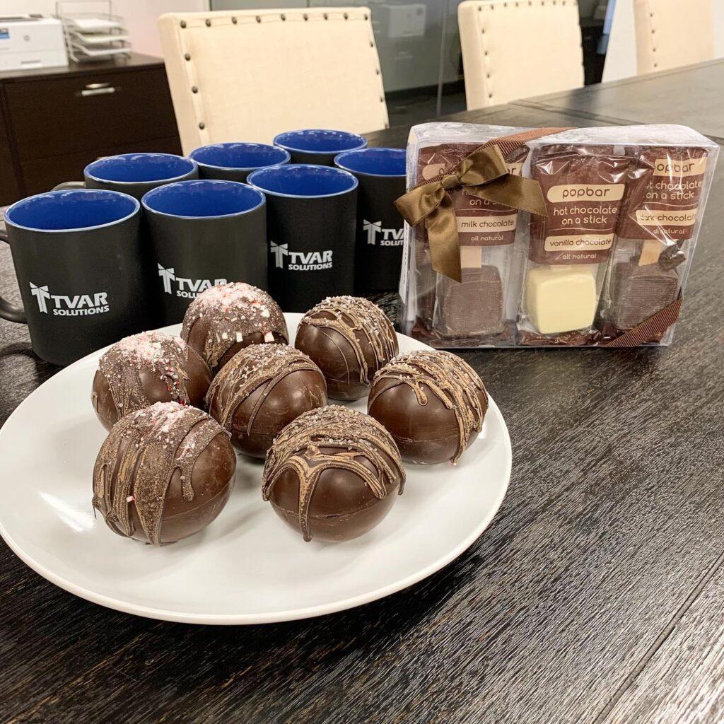 Peppermint Hot Chocolate Bombs, Sea Salt Caramel Hot Chocolate Bombs, Hot Chocolate on a Stick, and TVAR Solutions Mugs